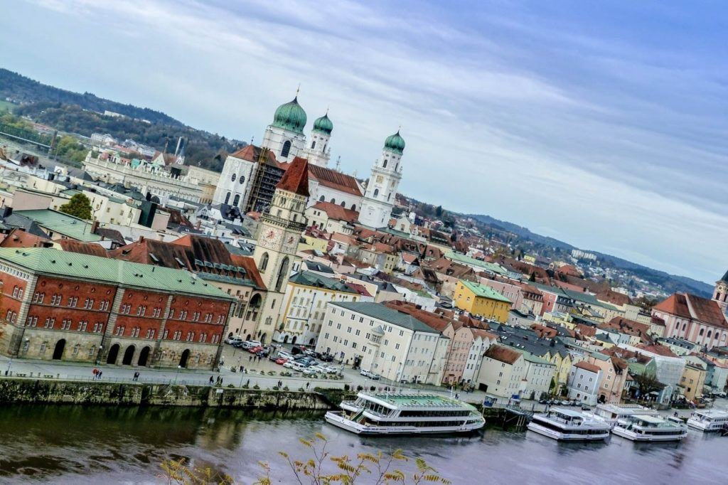 River cruise ships moored at the town docks in Passau.