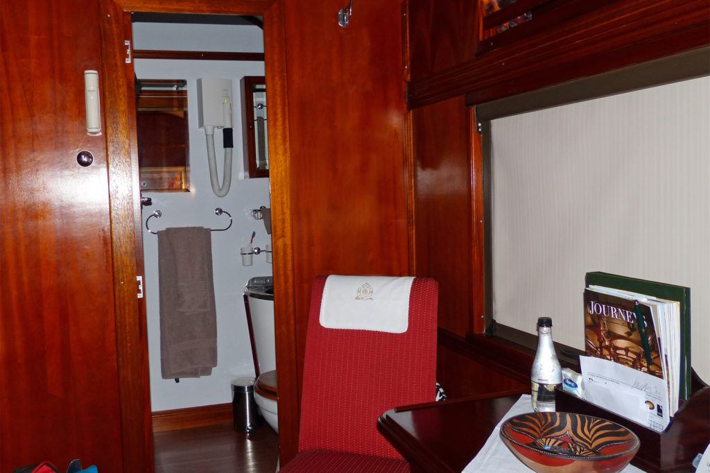 Partial view of the sitting area and bath in a Rovos Rail suite.