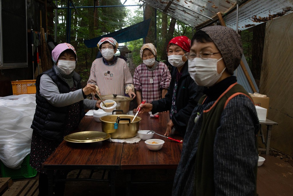 Village women serving hot vegetable soup to visitors of the red buckwheat flower fields and the festival.