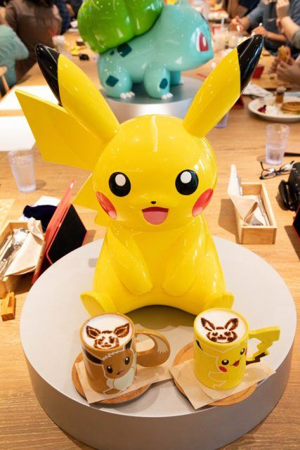 Pikachu, and coffees with Pikachu and Evie on them.