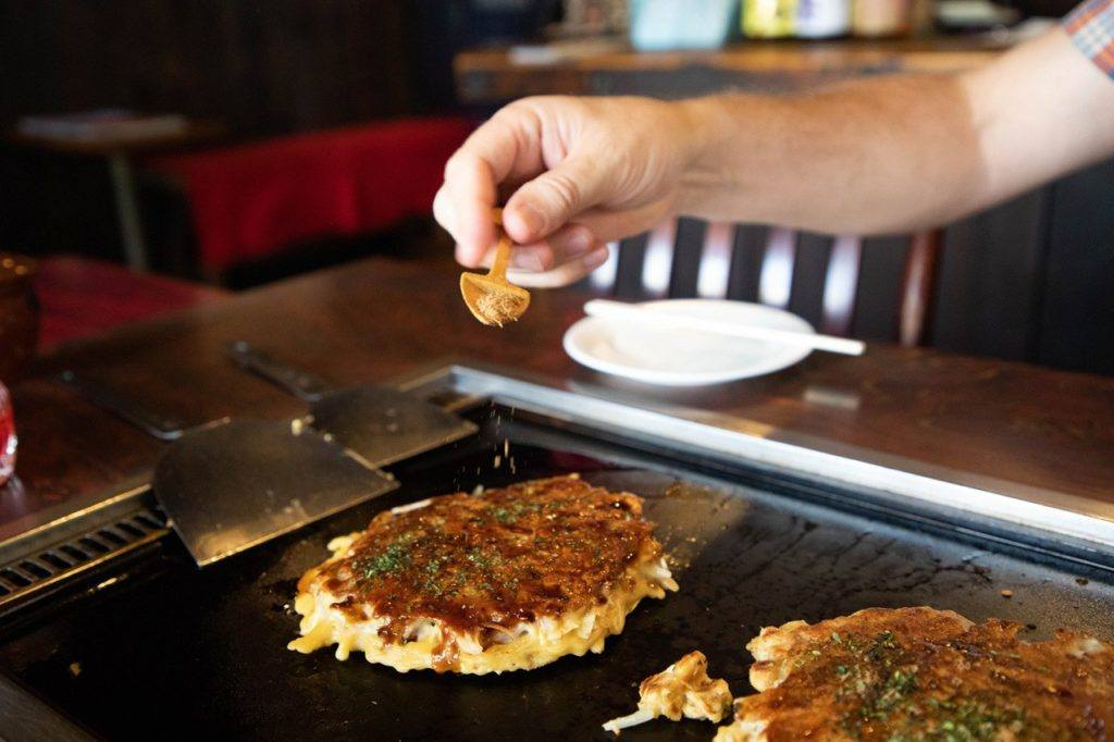 Cooking okonomiyaki right at the table in Sometaro, one of our favorite restaurants in Kamakura.