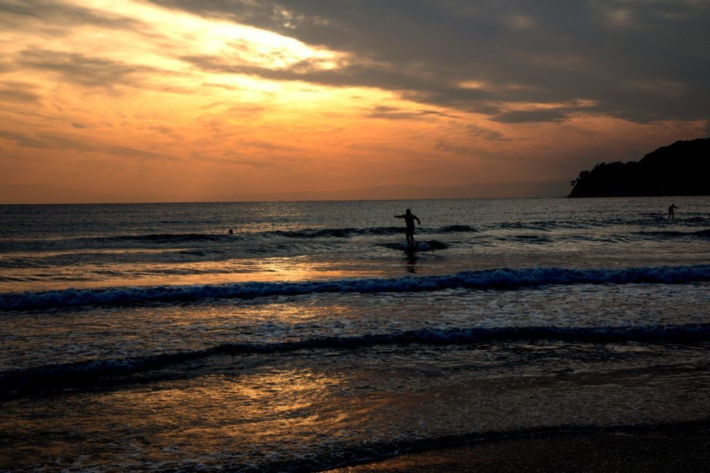 Surfers ride the waves all year long in Kamakura.