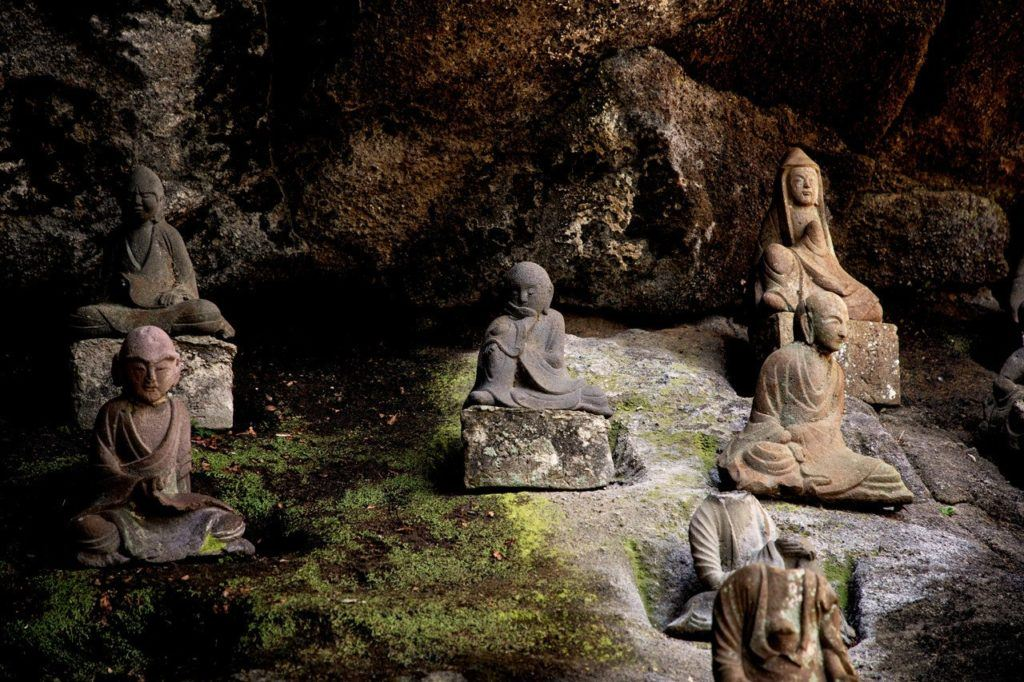 Small statues called rakkan line much of the path on Nokogiriyama.