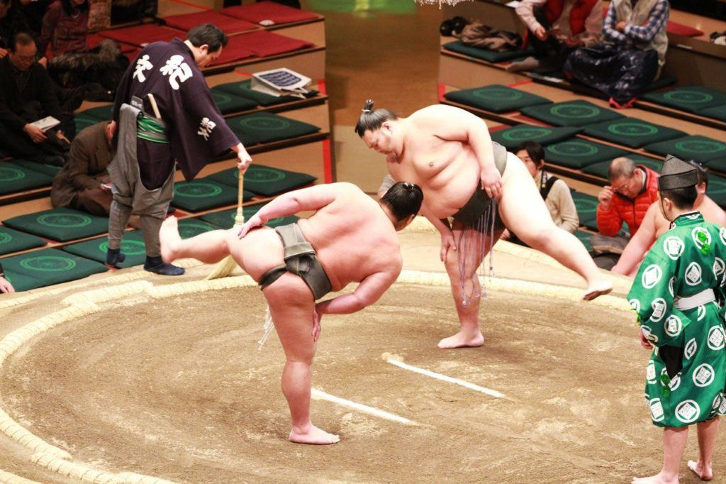 Competitors completing the ritual before the Sumo match begins.