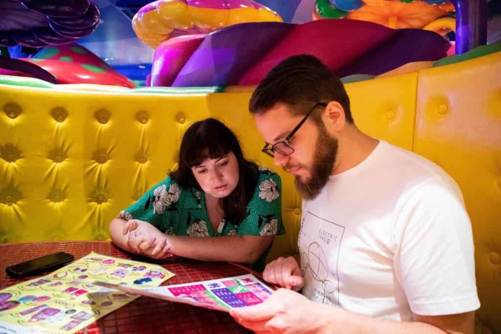 Checking out the menu and shop items offered by the Kawaii Monster Café.
