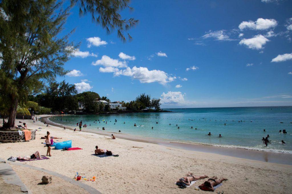 People sunbathing on the beach.