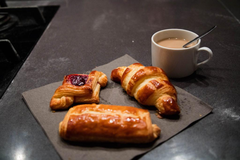 A cup of coffee and the pastries we made in our baking class in Paris.