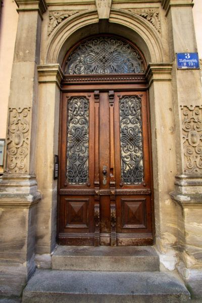 Ornate wooden door with beautiful wrought iron work.