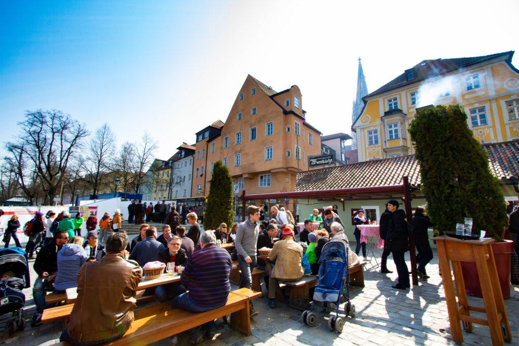Customers enjoying the famous Wurstkuchl's sausages.