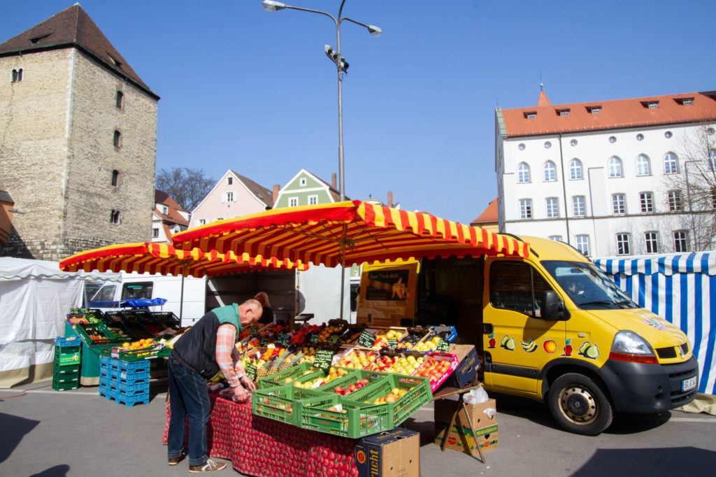 Produce Vendor sets up to sell at the Regensburg weekly market.