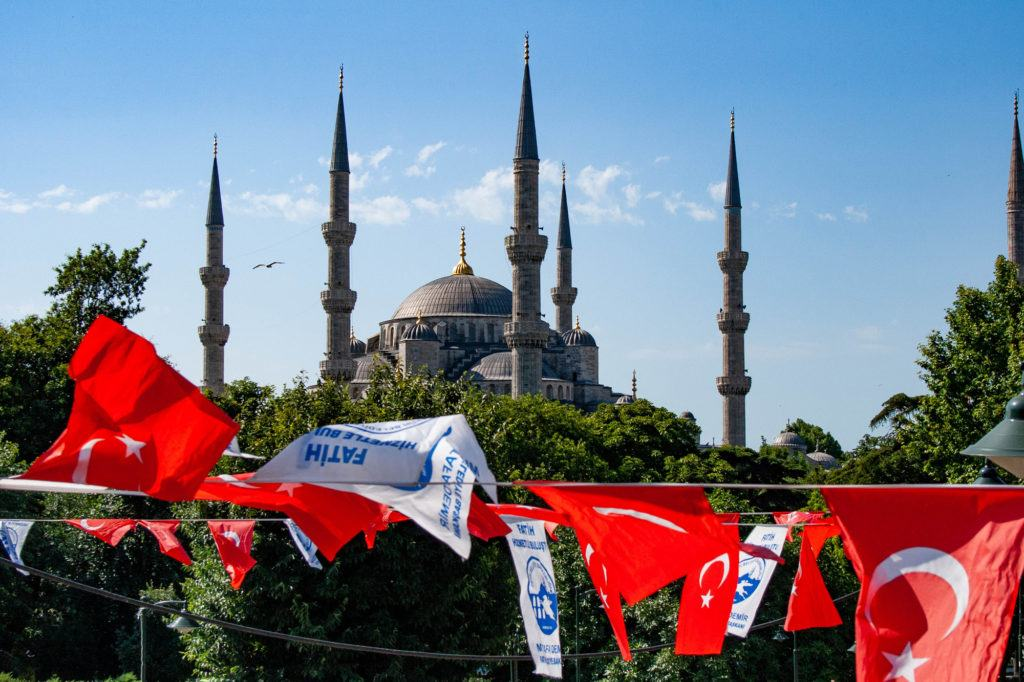 Blue Mosque with Turkish banners in front, some flags.