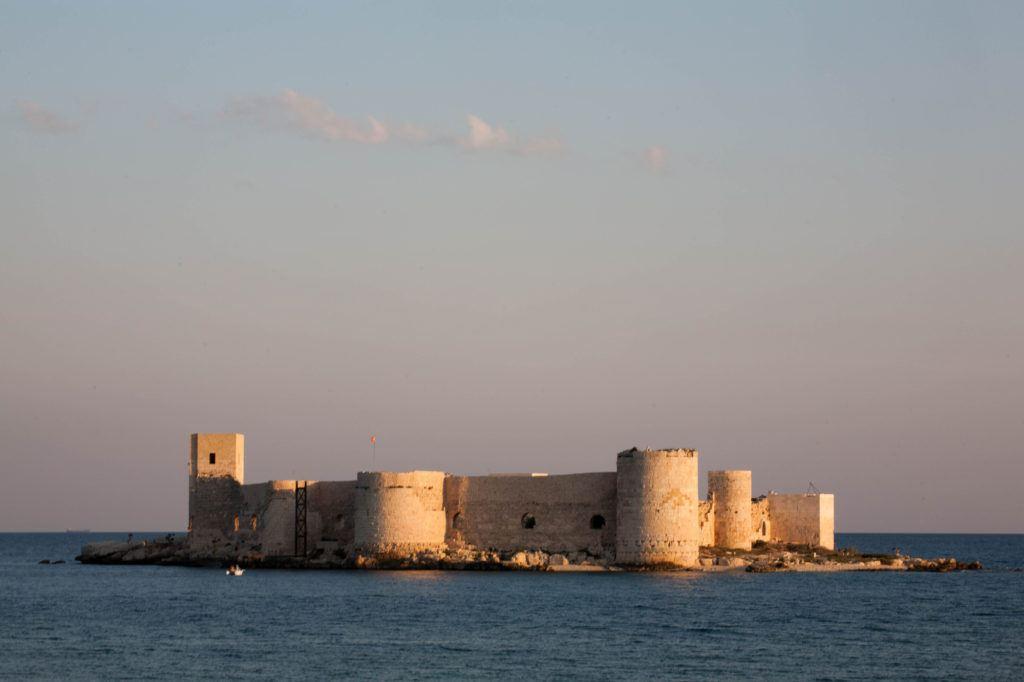 The sun sets on the Maiden Castle, right off the shore of Kizkalesi.