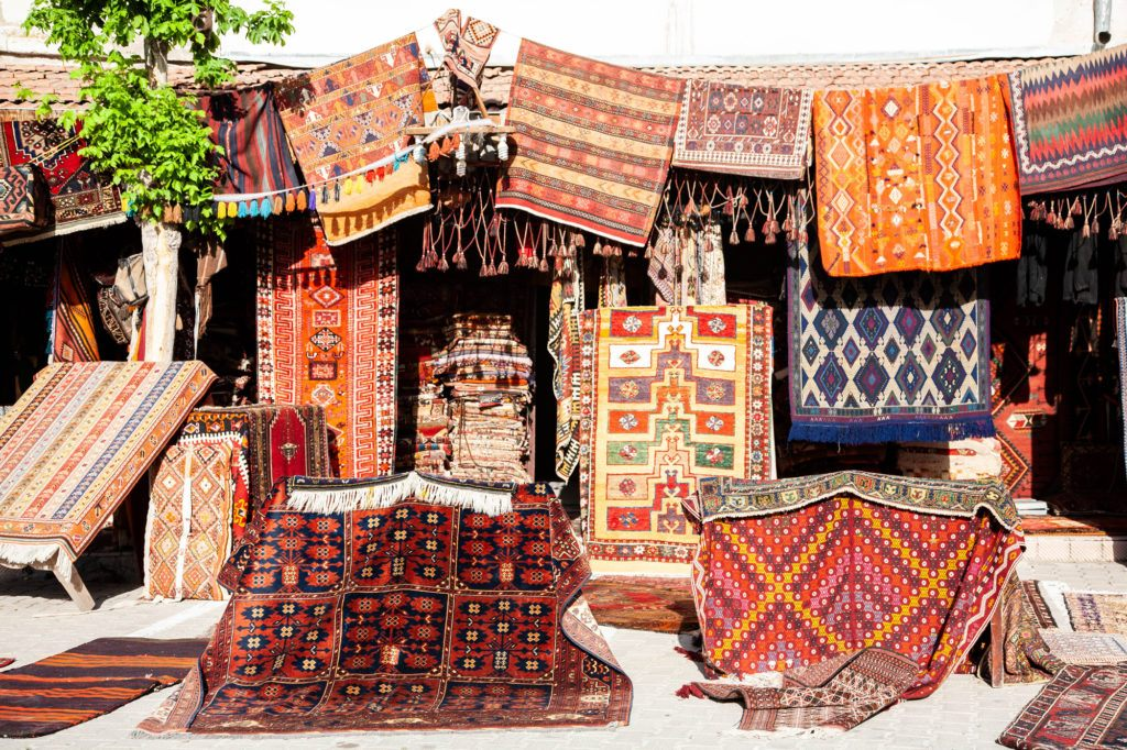 Rug Vendor with rugs and kilims outside of the shop.