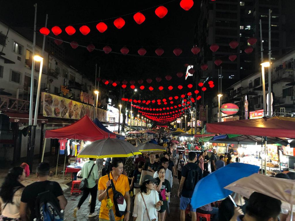 Jalon Alor, the famous night food street, even in the rain.