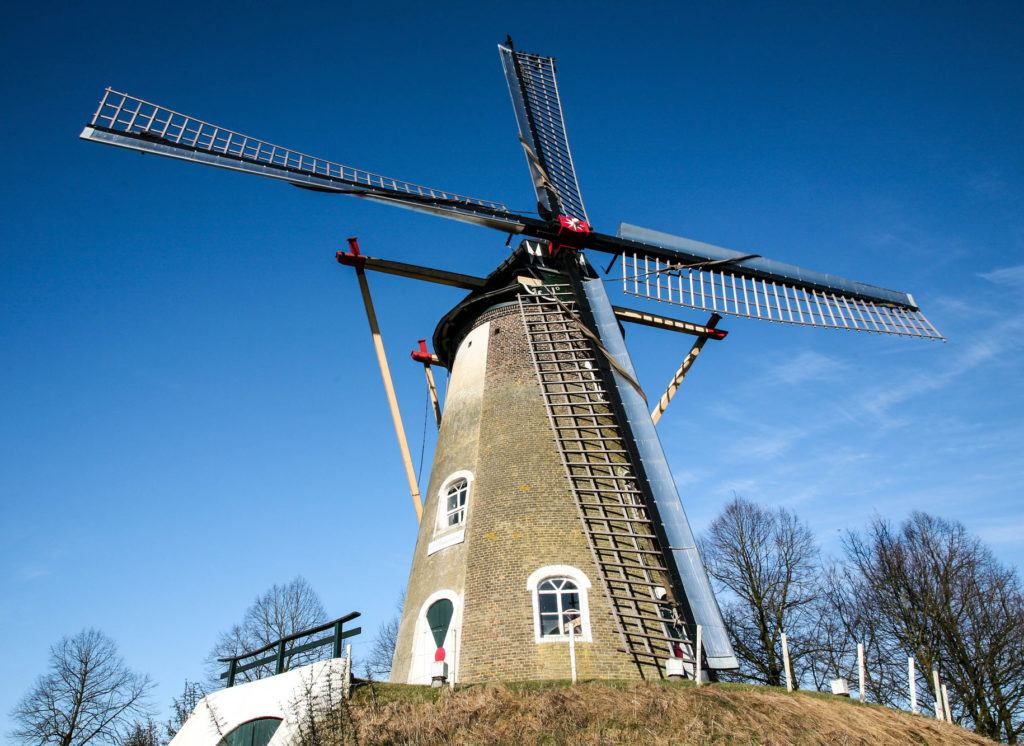 A windmill stands on a hill. It's truly the symbol of the Netherlands.