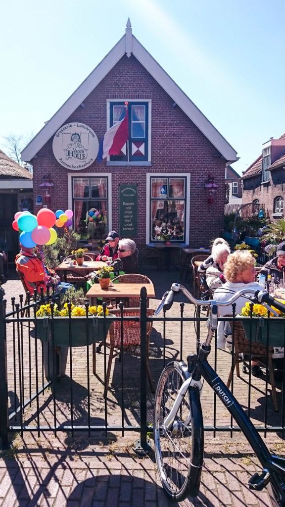 On a sunny spring day lots of folks are out bike riding and stop for a drink and pannekoeken.