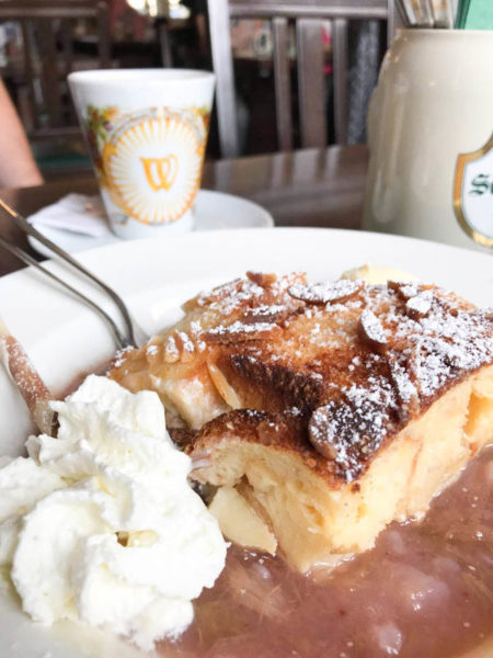 Not sure what to eat in Germany? Try a German dessert of bread pudding and whipped cream.