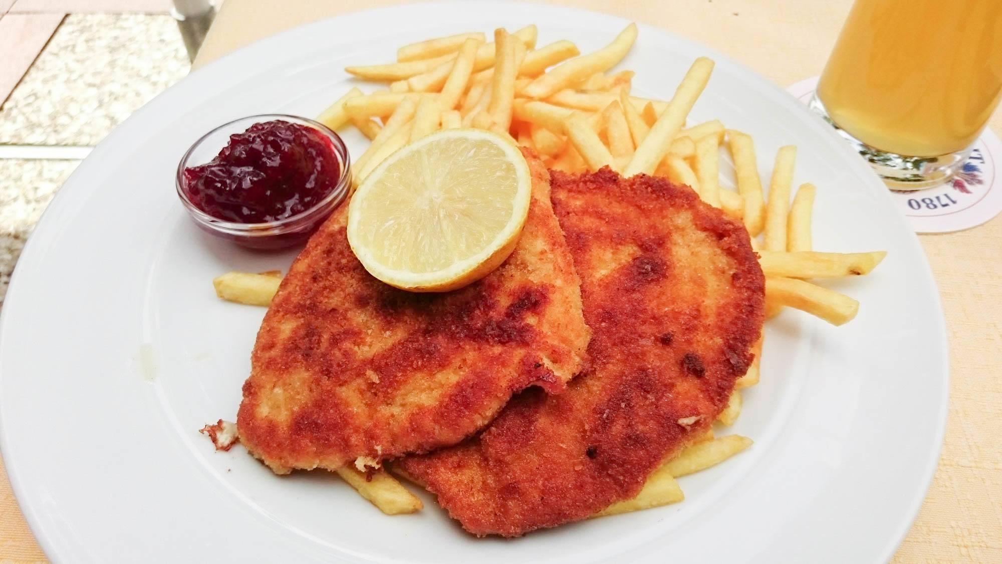 Typical schnitzel with fries and preiselbeeren sauce.