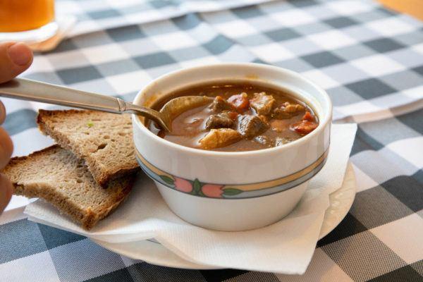 A bowl of gulasch soup.