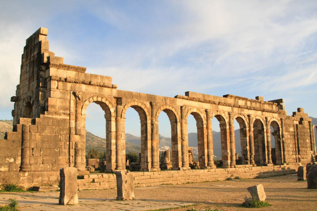 In Volubilis, Morocco, the massive row of arches from the Roman Basilica are still standing after more than 2000-years.