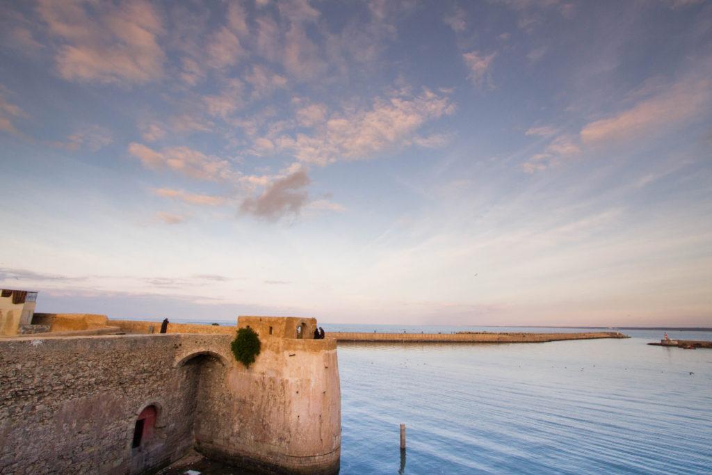 El Jadida fortress and harbor at sunset.