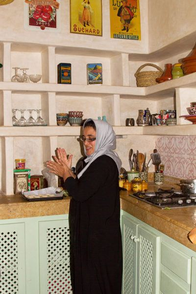 Our host at Dar Dayana prepares our breakfast in her spotless, well-organized kitchen.