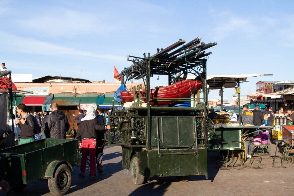 Two-wheeled carts, piled high with equipment, are actually pop-up restaurants with seating, tables and cooking equipment.