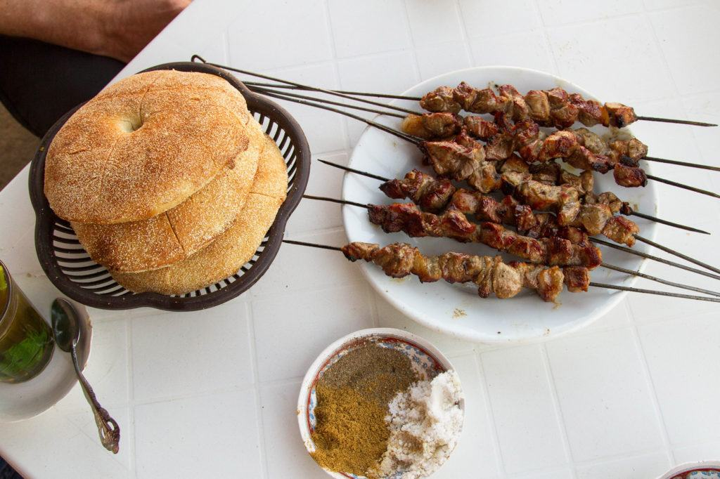 Our great lunch of fresh bread and lamb kebabs grilled in front of us.