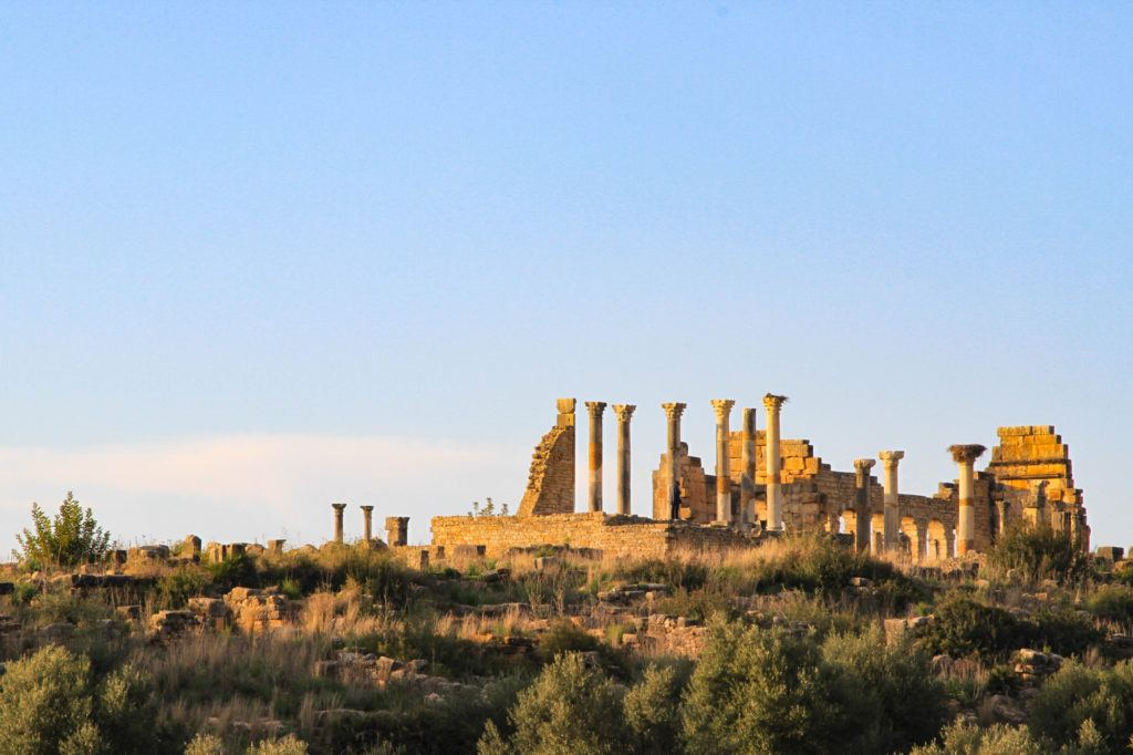 Looking up at the Roman Basilica ruins in Volubilis, Morocco, A UNESCO World Heritage Site.