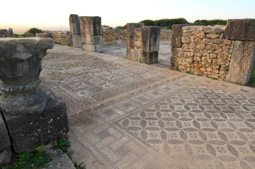 A mosaic floor in Volubilis with intricate geometric designs.