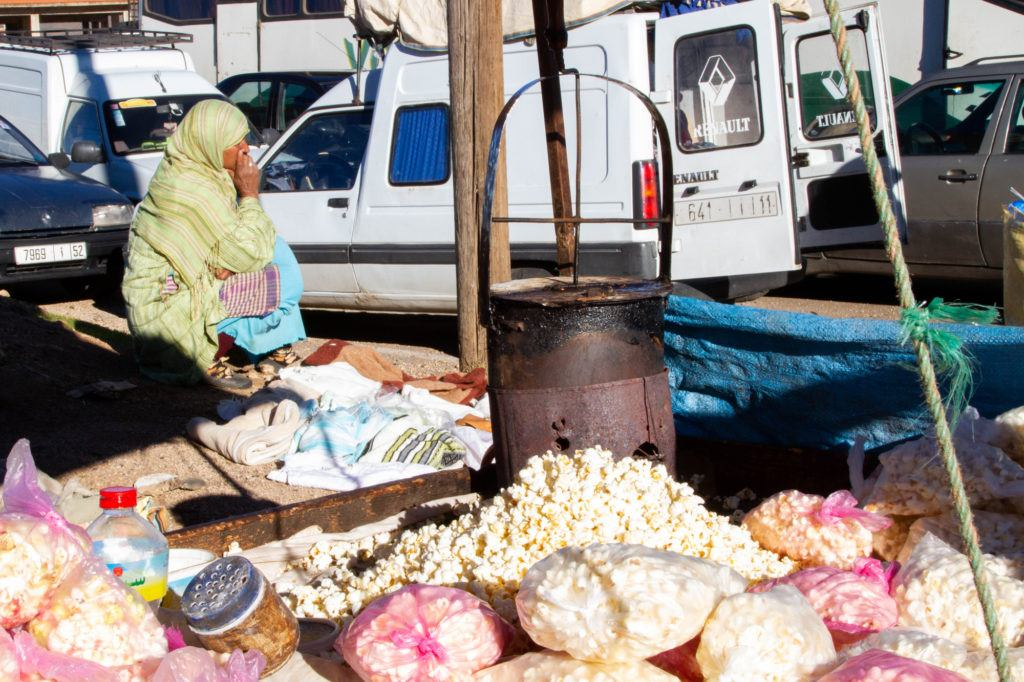 A vendor sells bags of popcorn on the road leading to the Berber Market in Azrou, Morocco.