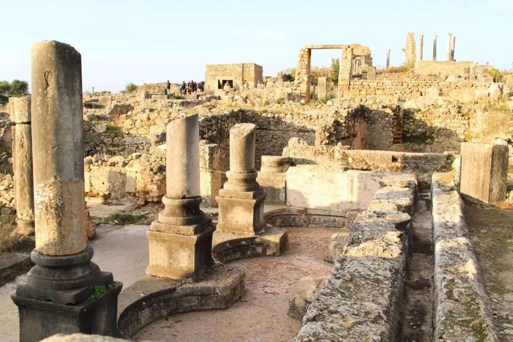 When visiting Volubilis, walk among the ruins to see Roman architecture up close.