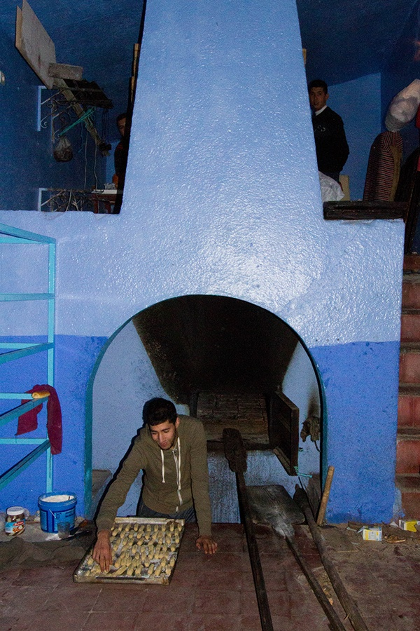 A baker prepares his dough to be baked in the traditional Moroccan oven.