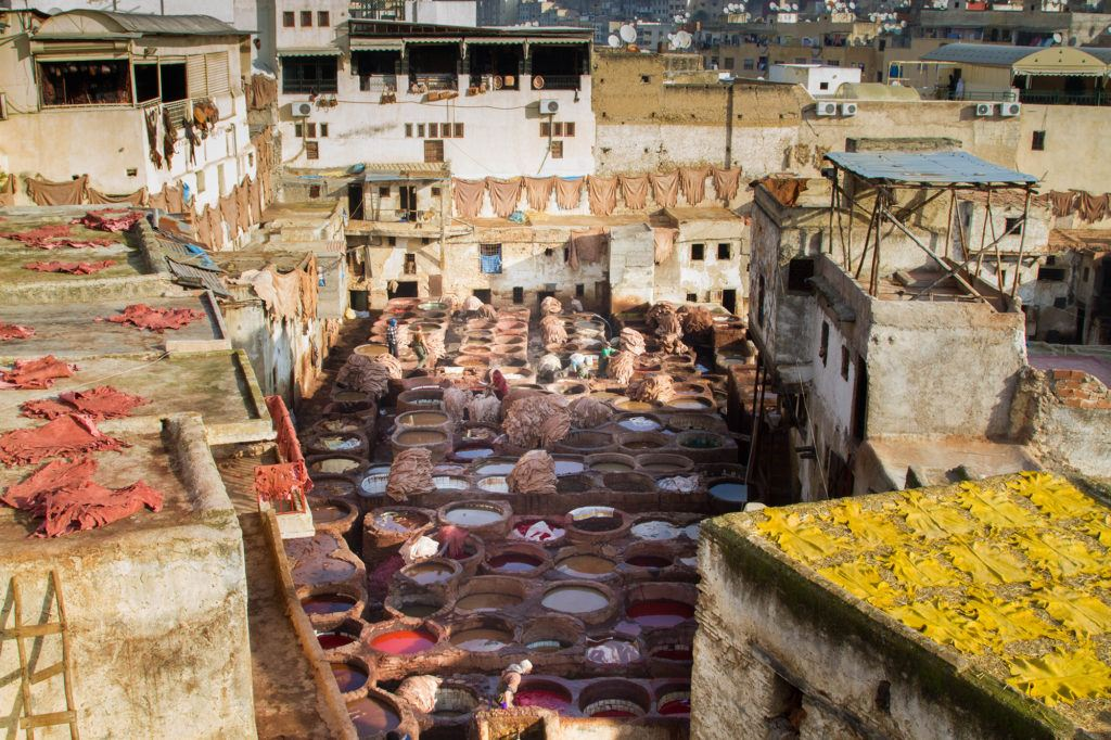 What a stunning scene with red and yellow skins drying on the roof tops and in between an area with at least 100 tannery pots.