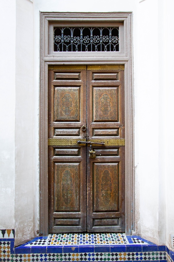 Door with decorative panels inside Bahia Palace Marrakesh Morocco.