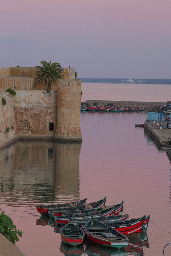 Red fishing boats anchored in the harbor in El Jadida, a UNESCO World Heritage Site.