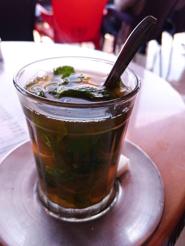 A steaming glass of authentic Moroccan Mint Tea.