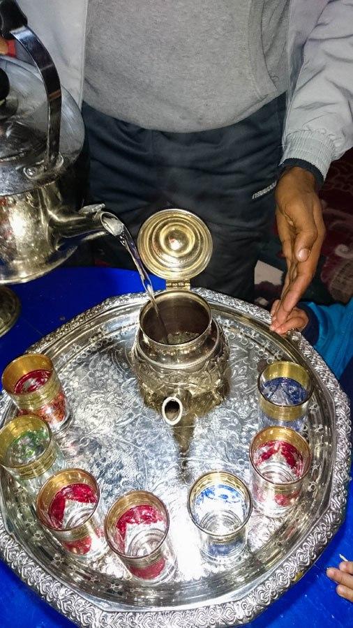 Adding water to steep the tea.