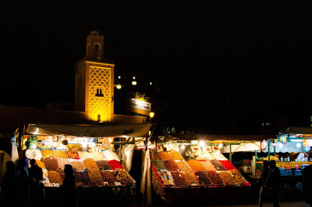 Spices and Minaret lit up in the Marrakech Medina.