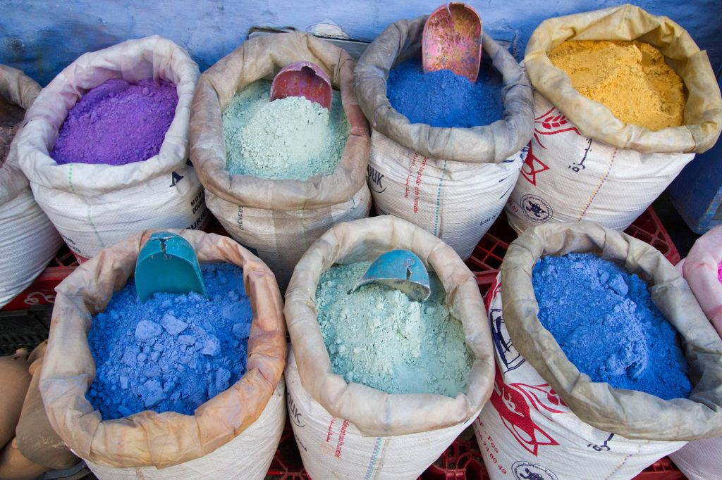 Outside a shop, these bags of dyes show how popular blue is.