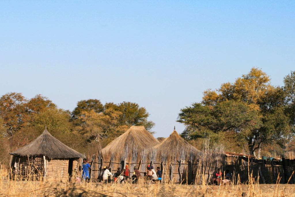 On our one day on the Caprivi Strip Namibia we found this Namibian village of thatched huts with people gathered outside.