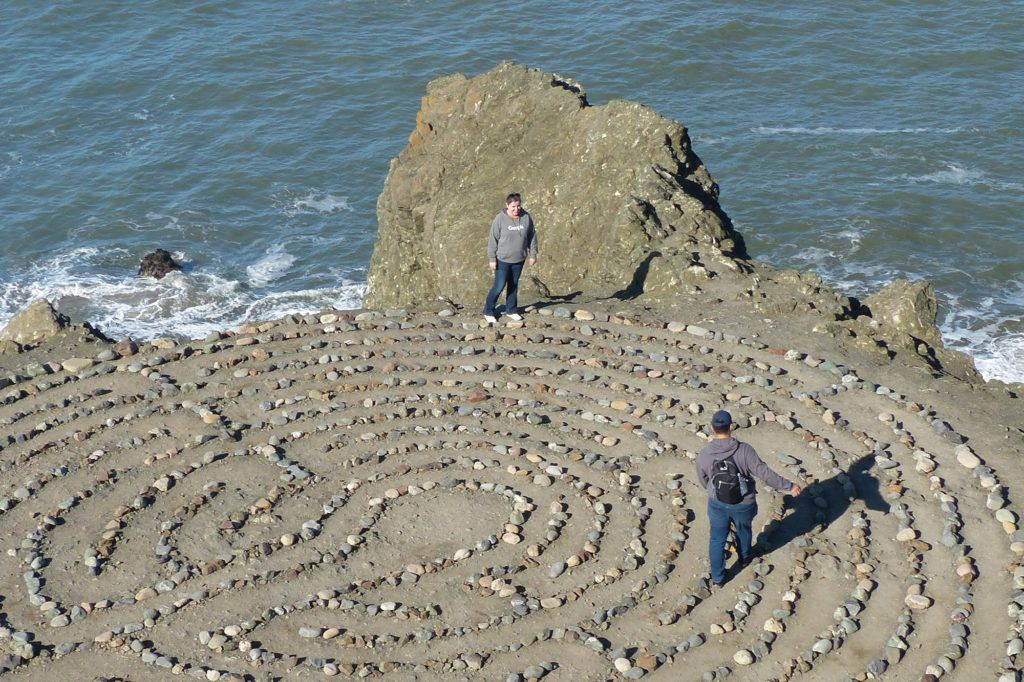 Young man wearing his best day pack while walking the Labyrinth on Lands End Trail in San Francisco.