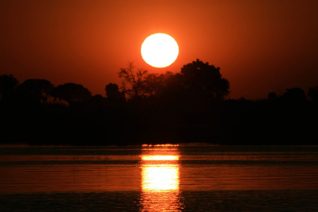 Sunset over the Chobe River from our cruise boat.