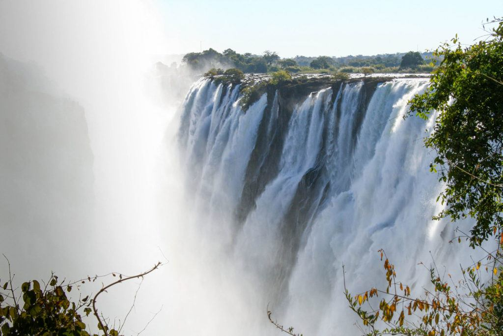 Tons of water from the Zambezi River goes over Victoria Falls and the spray gets everyone wet.