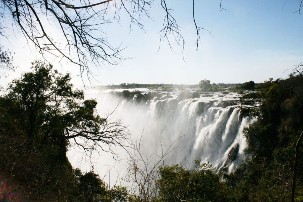 A cloud of mist rises up as an incredible amount of water from the Zambezi River flows over Victoria Falls in Zambia.