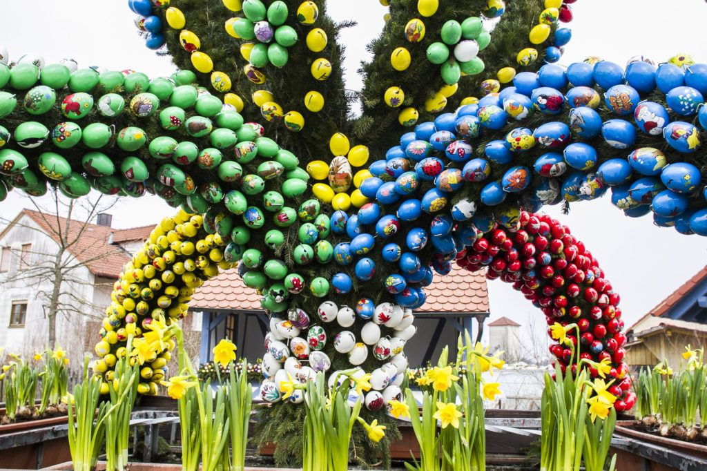 Daffodils and brightly colored Easter Eggs decorate this Franconian village Osterbrunnen.