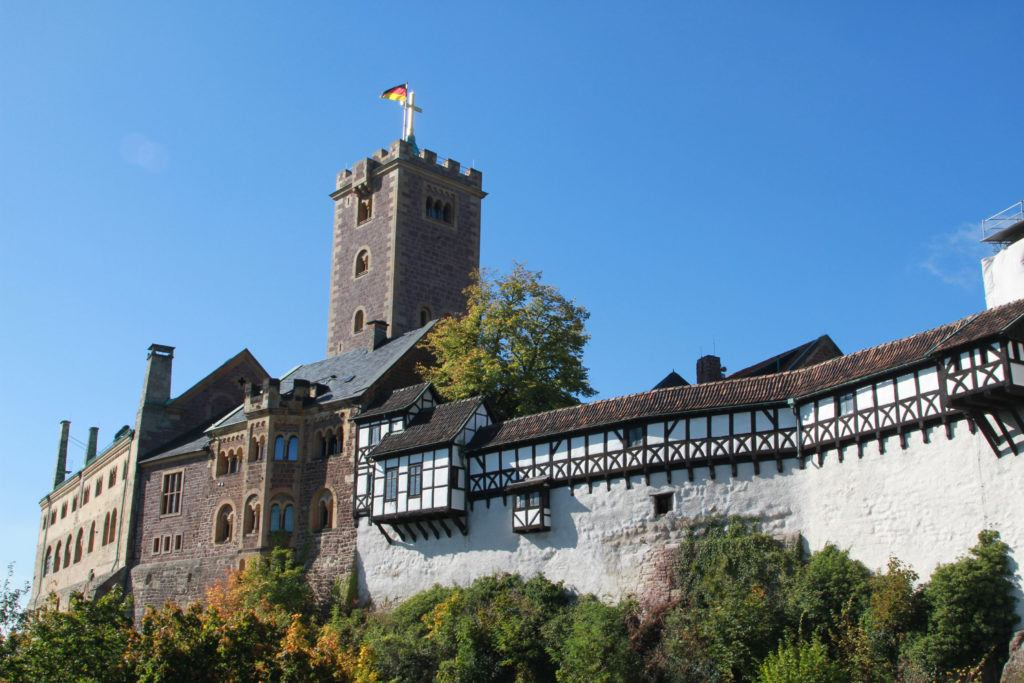 Wartburg Castle, a UNESCO World Heritage-Site, has an interesting history and is a great place to visit in Germany in spring.