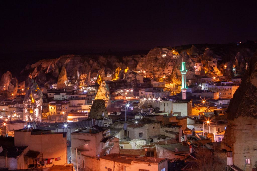 Goreme is the largest city in Cappadocia and it shines at night with the minaret and rock formations illuminated.