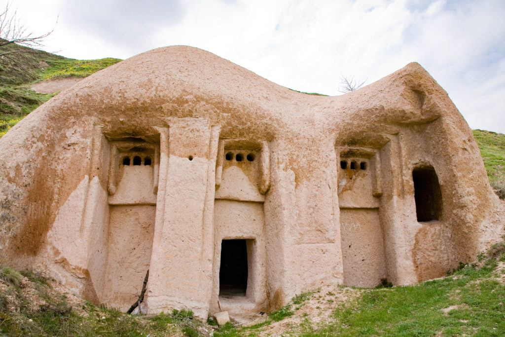 Cappadocia caves can be quite whimsical like this home carved into a stone hillside in Uchisar.