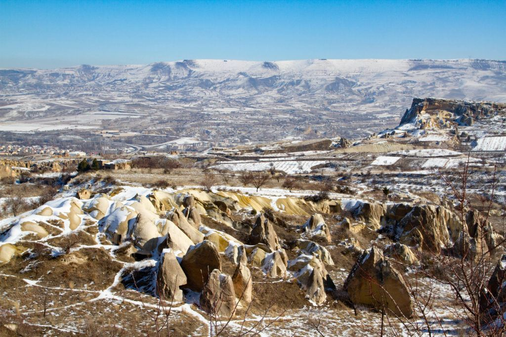 Cappadocia hills with a fresh dusting of snow on the ground.